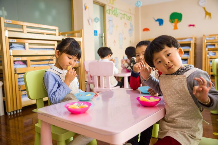 daycare alternatives - group of asian toddlers at a table