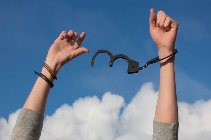 get out of debt - hands freed from handcuffs