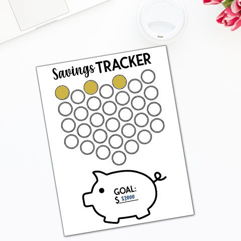free piggy bank savings tracker with coins being inserted into piggy bank