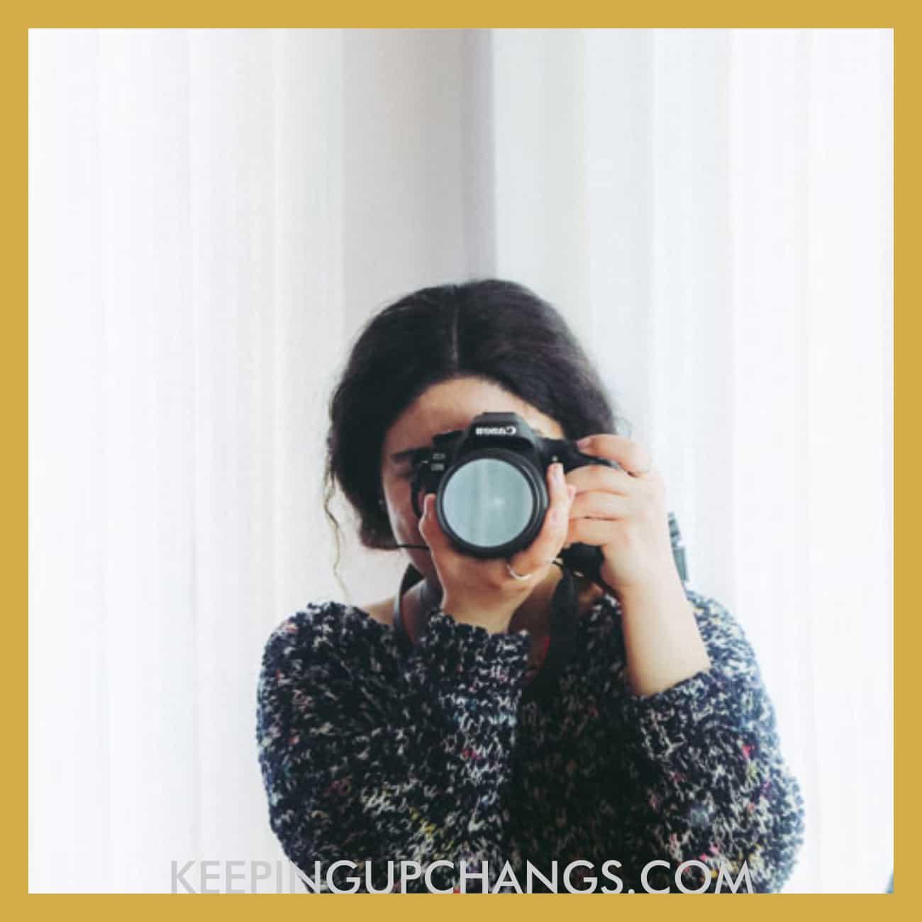 girl pointing camera lens to take photo.