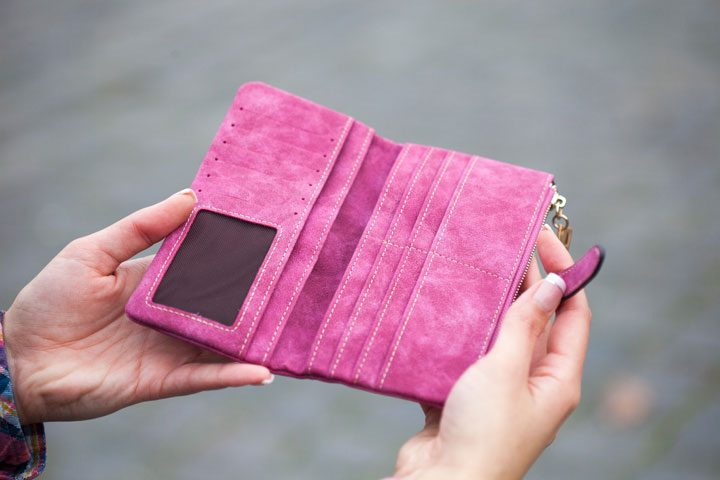 woman holding upen empty wallet